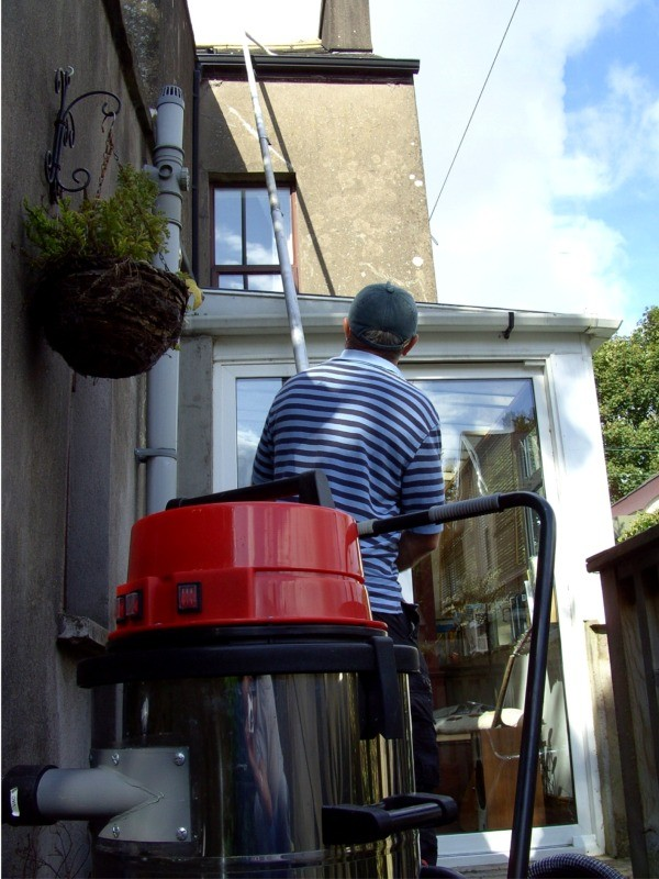 Advanced long pole gutter cleaning technology with gentle cleaning action - gutter cleaning by  G M Window Cleaning Services, Cork, Ireland